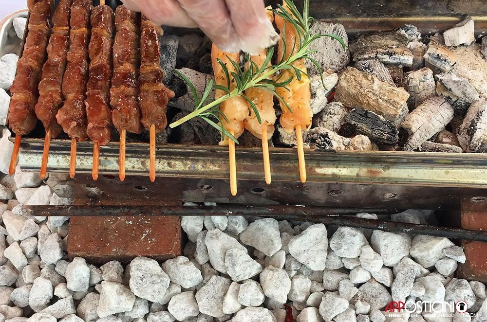 arrosticini cooking on fire and white rock cucina abruzzese italian food NYC New York