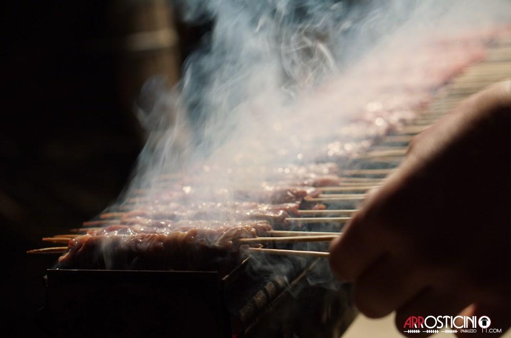 arrosticini cooking on fire cucina abruzzese italian food NYC New York